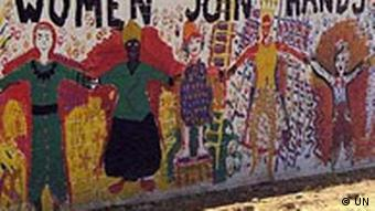 A mural with the motto 'women join hands'