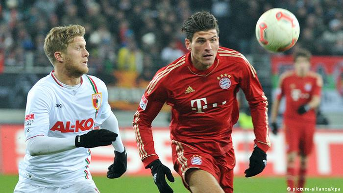 Mario Gomez chases the ball during a Bayern Munich game at Augsburg earlier this season. (Photo via dpa)