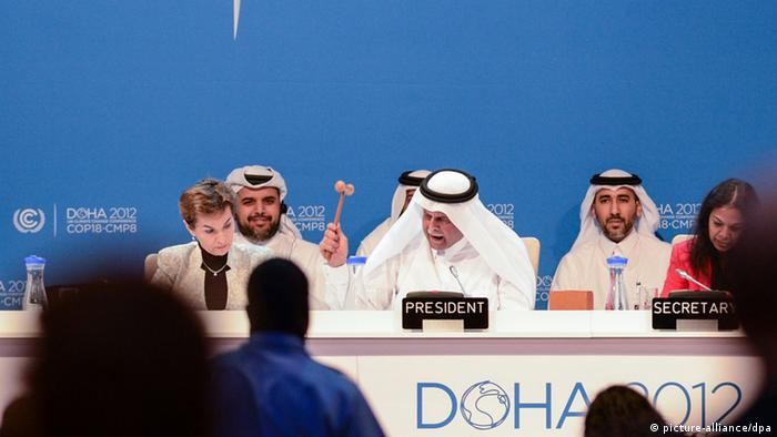 DOHA, Dec. 8, 2012 H.E. Abdullah Bin Hamad Al Attiyah (2nd R, front), President of the conference announces the final agreements of the UN Climate Change Conference (COP 18 and CMP 8) at the Qatar National Convention Center (QNCC) in Doha, Qatar, Dec. 8, 2012. (Xinhua/Li Muzi