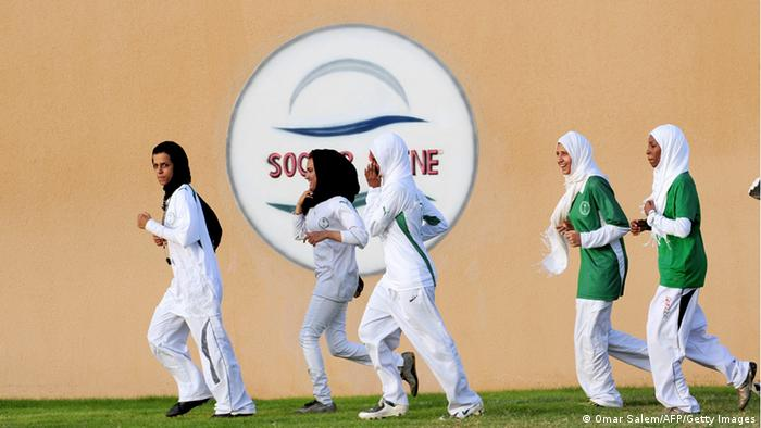 Saudi members of the King's United women football club train at a stadium in the Red sea port of Jeddah on May 20,2009, despite strict religious taboos in the desert kingdom. Some 36 Saudi female football players train on daily basis behind closed walls away from the prying eyes of men. They have divided themselves into three teams to compete against each other in a country where sports for women is strictly forbidden. AFP PHOTO/OMAR SALEM (Photo credit should read Omar Salem/AFP/Getty Images)