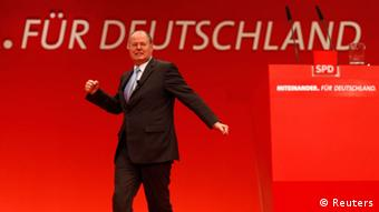 Peer Steinbrueck delivers his speech during the extraordinary party meeting of the SPD in Hanover, December 9, 2012.