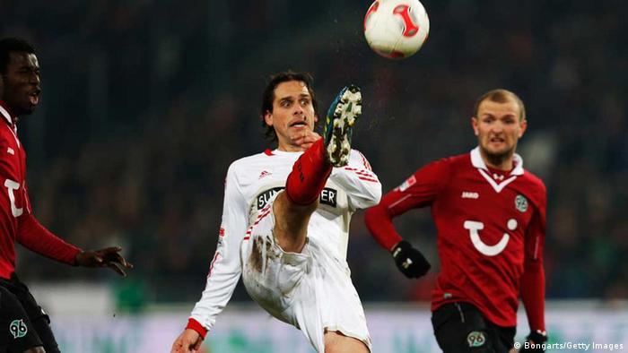 Konstantin Rausch (R) of Hanover and Manuel Friedrich of Leverkusen compete for the ball