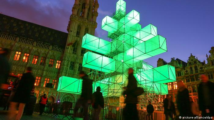 An electric Christmas tree made of what appear to be green boxes lit from within (Photo: EPA/JULIEN WARNAND)