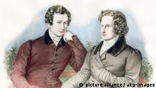 """1-G61-K1829-B (598565) 'Wilhelm (links) und Jakob Grimm' Grimm, Jacob; Germanist; (Hanau 4.1. 1785 - Berlin 20.9.1863) und sein Bruder Wilhelm Grimm; Germanist; (Hanau 24.2. 1786 - Berlin 16.12.1859). - 'Wilhelm (links) und Jakob Grimm'. - Lithographie, 1835, von Franz Hanf- stängl (1804-1877) nach Zeichnung, 1829, von Ludwig Emil Grimm (1790-1863). Spätere Kolorierung. E: 'Wilhelm (left) and Jacob Grimm' Grimm, Jacob; German author; Hanau 4.1. 1785 - Berlin 20.9.1863; and his brother Wilhelm Grimm; German author; Hanau 24.2.1786 - Berlin 16.12.1859. - 'Wilhelm (left) and Jacob Grimm'. - Lithograph, 1835, by Franz Hanfstängl (1804-1877) after drawing, 1829, by Ludwig Emil Grimm (1790-1863). Colourised at a later date. F: 'Wilhelm (là g.) et Jakob Grimm' Grimm, Jacob (Hanau 4.1.1785 - Berlin 20.9.1863) et son frère Wilhelm Grimm (Hanau 24.2. 1786 - Berlin 16.12.1859), linguistes, philologues et collecteurs de contes de langue allemande. - 'Wilhelm (là g.) et Jakob Grimm'. - Lithographie, 1835, de Franz Hanfst""""ngl (1804-1877) d'ap. dessin, 1829, de Ludwig Emil Grimm (1790-1863). Coloriée ultérieurement."""
