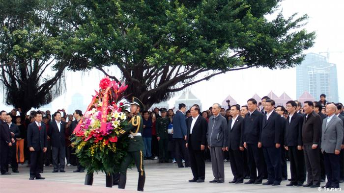Xi Jinping looks on as a wreath of flowers is offered to a bronze statue of China's late paramount leader Deng Xiaoping on Lianhua hill in Shenzhen.