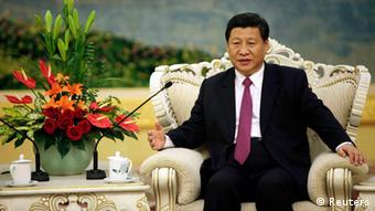 China's Vice President Xi Jinping speaks with Egypt's President Mohamed Mursi (not pictured) during a meeting at the Great Hall of the People, in Beijing, in this August 29, 2012 file photo. In his first three weeks as China's Communist Party boss, Xi Jinping has shown himself to be more confident, direct and relaxed than his predecessor - but also quick to invoke nationalistic themes to win public support and legitimacy. To match story CHINA-XI/ REUTERS/How Hwee Young/Pool/Files (CHINA - Tags: POLITICS)