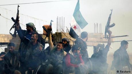 Members of the Free Syrian Army shout slogans against Syrian President Bashar al-Assad