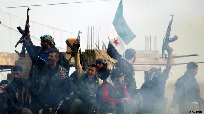 Members of the Free Syrian Army shout slogans against Syrian President Bashar al-Assad