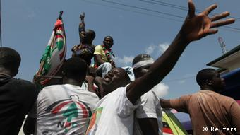 Supporters of National Democratic Congress (NDC) celebrate the victory of their candidate, John Dramani Mahama, REUTERS/Luc Gnago (