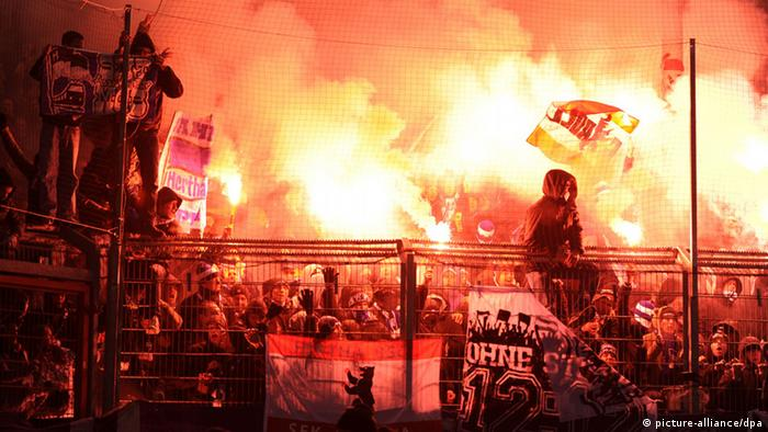 FC Energie Cottbus vs. Hertha BSC, 03.12.2012 , flares burn in a large segment of the stands