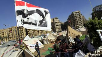 Anti-Morsi protesters with a flag that reads No, to Constitution