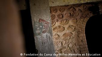 entrance of the kiln turned theatre at les milles, which shows etching of a Greek comic/tragic mask