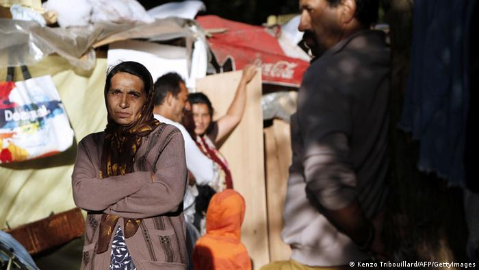 Members of the Roma community stand in a camp in Evry, outside Paris (Kenzo Tribouillard/AFP/GettyImages)