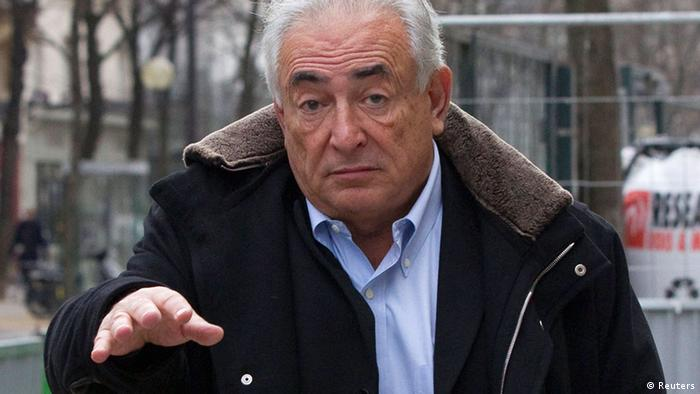 Former IMF head Dominique Strauss-Kahn gestures as he leaves his apartment in Paris December 10, 2012. Lawyers for Strauss-Kahn and Nafissatou Diallo, the hotel maid who accused him of sexual assault, were ordered to appear before New York state court on Monday to brief a judge on the status of settlement talks in the maid's civil case against him. REUTERS/Gonzalo Fuentes (FRANCE - Tags: POLITICS CRIME LAW)