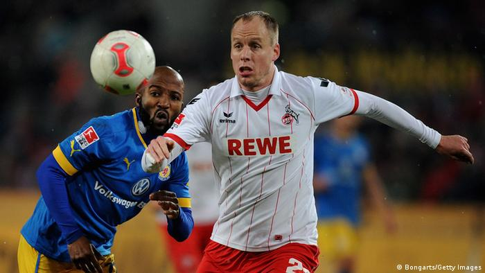 Kevin McKenna of Cologne and Dominik Kumbela (Photo by Dennis Brombkowski/Bongarts/Getty Images)