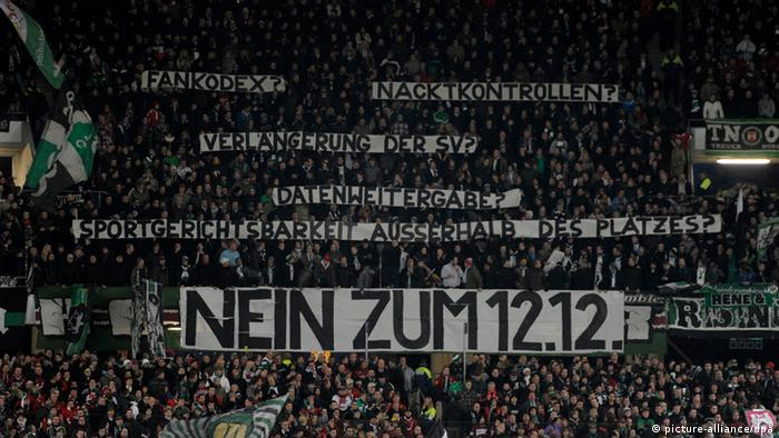 Fans hold banners saying no to 12:12 and other similar messages in a Hannover 96 (H) vs Borussia Mönchengladbach match on October 28, 2012.