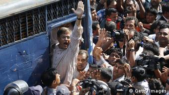 Opposition secretary-general for the Bangladesh Nationalist Party (BNP), Mirza Fakhrul Alamgir, shout slogans after a court sent 33 opposition figures to jail including lawmakers and senior officials ahead of their trial over violence at a series of anti-government protests in Dhaka on May 16, 2012. The court order sparked demonstrations outside the court by supporters of the BNP, forcing police to use batons to disperse them. AFP PHOTO/ STR (Photo credit should read STRINGER/AFP/GettyImages)
