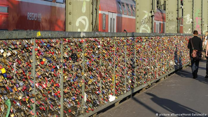 Thousands of padlocks hang from the frame of the Hohenzollern Bridge in Cologne