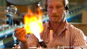 Glassblower Gerd Zinner making a sculpture out of glass in his workshop in Lauscha