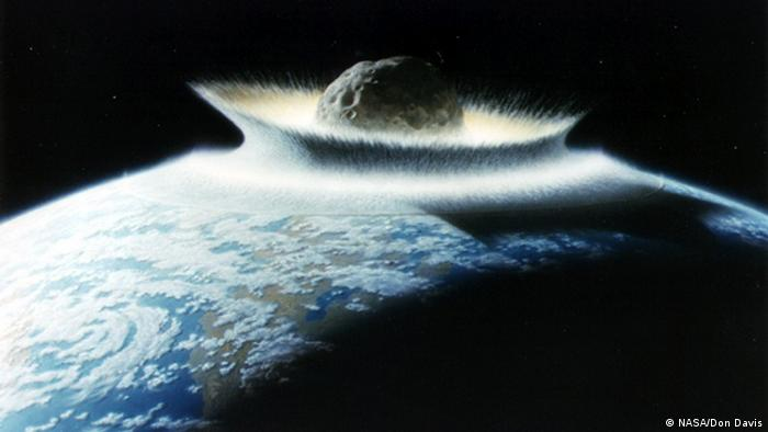 Artist rendition of asteroid smashing into Earth