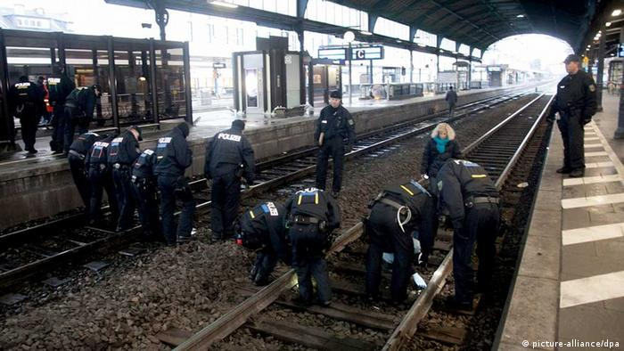 Police check the tracks at the Bonn train station after the bag with the bomb was found