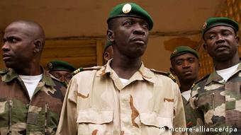 epa03176926 Mali coup leader Captain Amadou Sanogo (C) looks on after holding talks with Malian parliamentary speaker, Dioncounda Traore (not pictured) at the junta headquarters in Kati, outside of Bamako, Mali 09 April 2012. reports state that Captain Sanogo has signed an accord agreeing to return Mali to constitutional rule. Malian parliamentary speaker, Dioncounda Traore, is set to act as interim president and lead a transitional administration until elections. EPA/TANYA BINDRA