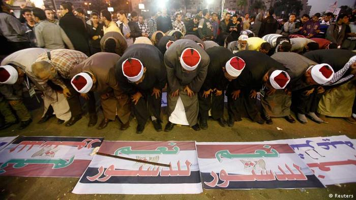 Morsi supporters perform prayers during a support rally December 11, 2012.
