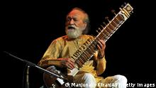 Ravi Shankar plays the sitar (Manjunath Kiran/AFP/Getty Images)