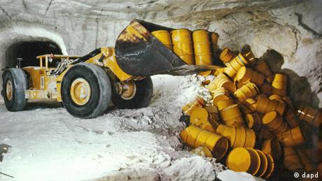 In this archive photo, barrels of radioactive waste are emptied into a salt mine called Asse.