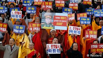 South Korean Buddhist monks shout during a protest blaming North Korea's rocket launch in central Seoul December 12, 2012. North Korea successfully launched a rocket on Wednesday, boosting the credentials of its new leader and stepping up the threat the isolated and impoverished state poses to its opponents. The rocket, which North Korea says put a weather satellite into orbit, has been labelled by the United States, South Korea and Japan as a test of technology that could one day deliver a nuclear warhead capable of hitting targets as far as the continental United States. REUTERS/Lee Jae-Won (SOUTH KOREA - Tags: MILITARY POLITICS SCIENCE TECHNOLOGY CIVIL UNREST RELIGION)