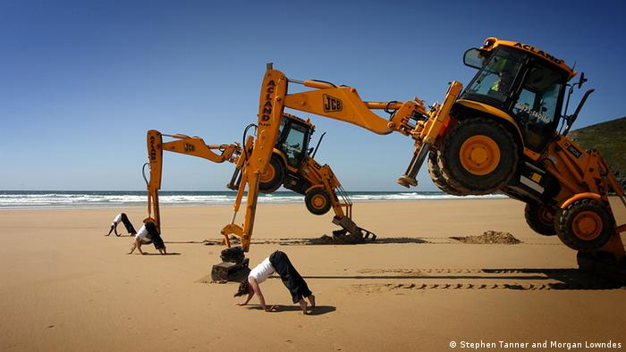 Bulldozers and humans in a performance by UK dance group Motionhouse