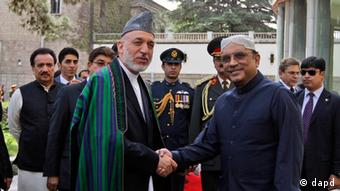 Afghan President Hamid Karzai, left, shakes hands with his Pakistani counterpart Asif Ali Zardari in Kabul, Afghanistan, Tuesday, July 19, 2011 (Photo: Omar Sobhani, Pool, Reuters/AP/dapd)
