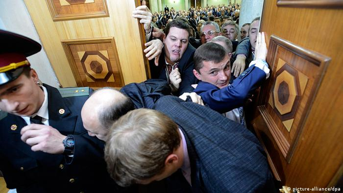 Ukrainian lawmakers scuffle prior to the opening ceremony of a new session of the Ukrainian 'Verkhovna Rada' (Supreme Council of Ukraine) parliament in Kiev, Ukraine, 12 December 2012. The newly elected Ukrainian parliament held its first session following the parliamentary elections on 28 October 2012. Media reports claim that opposition lawmakers were scuffling with two of their deputies whom they suspect were preparing to change to Ukrainian President Viktor Yanukovych's Party of Regions, that holds a small majority in the parliament. EPA/ANDREW KRAVCHENKO / POOL