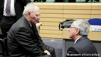 German Finance Minister Wolfgang Schaeuble (L) chats with President of the Eurogroup Luxembourg's Prime Minister Jean-Claude Juncker EPA/OLIVIER HOSLET