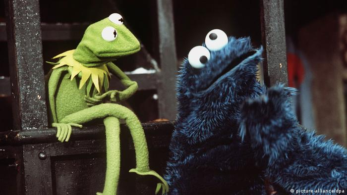 Kermit the Frog and the Cookie Monster, two chracaters from Sesame Street