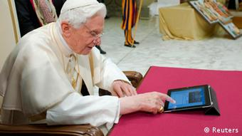 Pope Benedict XVI posts his first tweet using an iPad tablet after his Wednesday general audience in Paul VI's Hall at the Vatican December 12, 2012. REUTERS/Osservatore Romano (VATICAN - Tags: RELIGION SCIENCE TECHNOLOGY) FOR EDITORIAL USE ONLY. NOT FOR SALE FOR MARKETING OR ADVERTISING CAMPAIGNS. THIS IMAGE HAS BEEN SUPPLIED BY A THIRD PARTY. IT IS DISTRIBUTED, EXACTLY AS RECEIVED BY REUTERS, AS A SERVICE TO CLIENTS