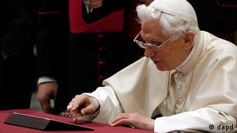 Pope Benedict XVI pushes a button on a tablet at the Vatican (Photo: Gregorio Borgia)