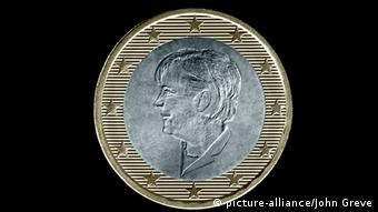 Image of a euro coin with the image of Angela Merkel