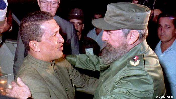 Cuban President Fidel Castro(R) greets Hugo Chavez(L) upon his arrival at Jose Marti Airport in Havana. Photo: ADALBERTO ROQUE/AFP/Getty Images