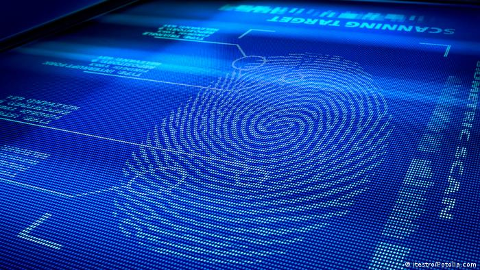 Identification system interface scanning a human fingerprint © itestro #26269271