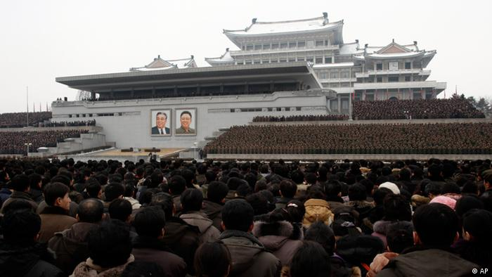 North Koreans gather near portraits of the late leaders Kim Il Sung, left, and Kim Jong Il during a mass rally organized to celebrate the success of a rocket launch that sent a satellite into space, on Kim Il Sung Square in Pyongyang, North Korea, Friday, Dec. 14, 2012 (Photo via AP)