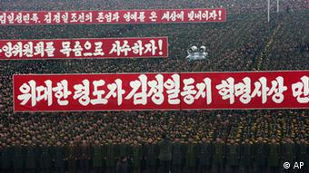 Slogans honoring the leadership are displayed during a mass rally organized to celebrate the success of a rocket launch that sent a satellite into space on Kim Il Sung Square in Pyongyang, North Korea, (Photo: Ng Han Guan/AP/dapd)