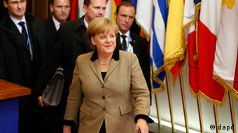 German Chancellor Angela Merkel leaves after an EU summit in Brussels on Friday, Dec. 14, 2012. Photo:Michel Euler/AP/dapd