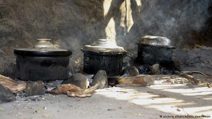 Cooking pots atop wood fires in Sudan (Photo: John Heeneman)
