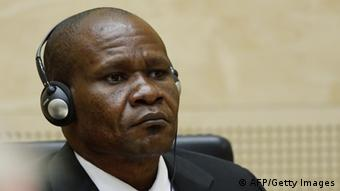 Mathieu Ngudjolo Chui with earphones listening to the closing arguments