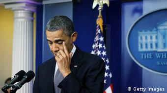 President Barack Obama wipes tears as he makes a statement (Photo by Alex Wong/Getty Images)
