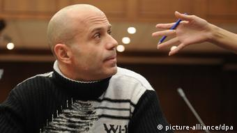 Former Moscow police chief Dmitri Pavlyuchenkov in court, December 2012. (Photo ITAR-TASS / Valery Sharifulin)