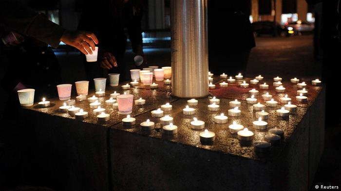 Candles commemorating victims of a Connecticut elementary school shooting burn during a vigil in Oakland, California, December 14, 2012. Twenty schoolchildren were slaughtered by a heavily armed gunman who opened fire at a suburban elementary school in Connecticut on Friday, ultimately killing at least 27 people including himself in the one of the worst mass shootings in U.S. history. The 20-year-old gunman, identified by law enforcement sources as Adam Lanza, fired what witnesses described as dozens of shots at Sandy Hook Elementary School in Newtown, Connecticut, which serves children from ages 5 to 10. REUTERS/Noah Berger (UNITED STATES - Tags: CRIME LAW EDUCATION)