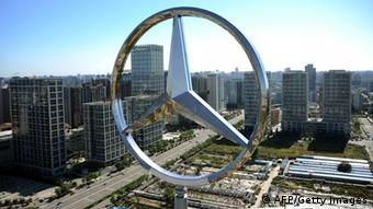 The giant logo of German vehicle maker Daimler's Mercedes-Benz sits on the top of its head office building in Beijing on October 11, 2010. Booming auto sales in China are leading manufacturers to step up production so fast that the government worries about 'blind investment' in the sector, were over capacities could be built up in a couple of years time, according to analysts. AFP PHOTO/GOU YIGE (Photo credit should read GOU YIGE/AFP/Getty Images)