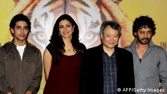 "GettyImages 154987726 Indian Bollywood actress Tabu (2L) and actors Irfan Khan (R), Suraj Sharma (L) pose during a promotional event for the forthcoming English film ""Life of Pi"" directed by Hollywood Oscar-winner Ang Lee (2R) in Mumbai late October 29, 2012. AFP PHOTO/STR (Photo credit should read STRDEL/AFP/Getty Images)"